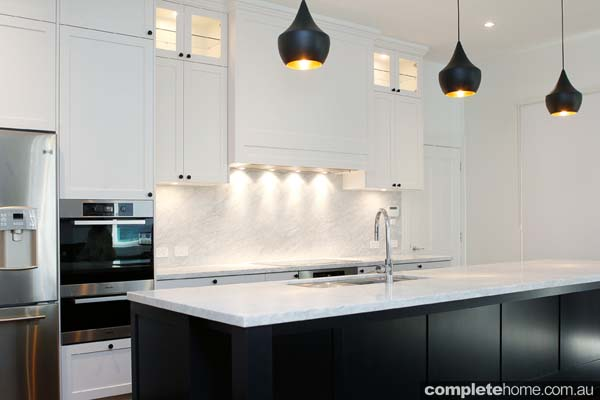 A black and white kitchen from The Kitchen Place.