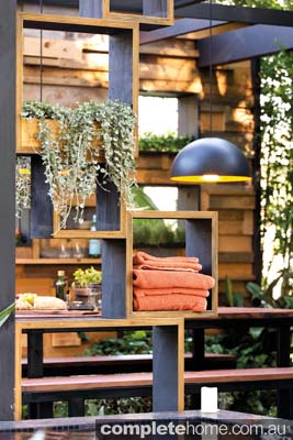 Timber shelving in the Cube2 outdoor garden.