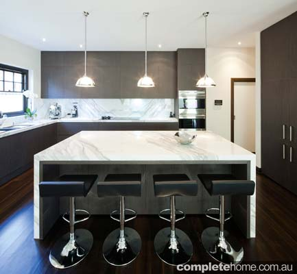 Minimalist statement kitchen from Mint Kitchen Group.