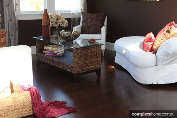 A living room featuring dark proline bamboo flooring.