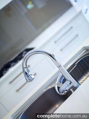 A sleek stainless steel tap in a contemporary bathroom from Brilliant SA.