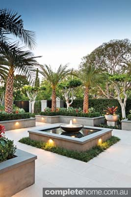 A formal water feature in a tropical landscape design from Franklin Landscape & Designs.
