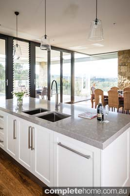 An elegant minimalist kitchen with a beautiful view.