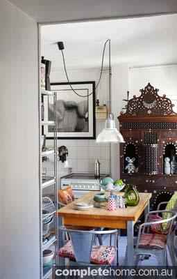 This apartment in Paris features a unique kitchen with a vintage design.