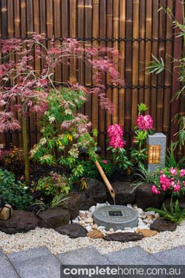 A water feature in an authentic Japanese garden from Kihara Landscapes.