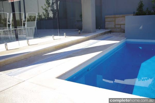 The clever cleardeck pool cover from Waterblade in it's closed position.