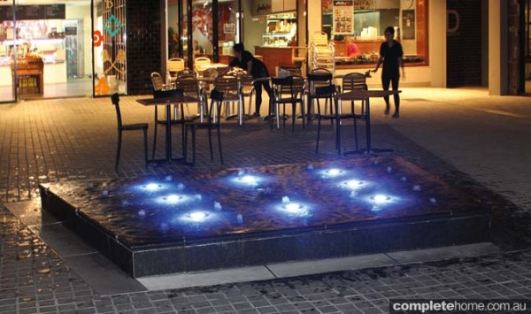 A water feature illuminated with Evo2 pool lighting from Aqua-Quip.