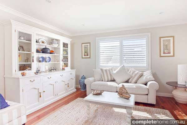 The living room in a light and traditional beach house from Classic Country Cottages.