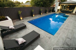outdoor pool design with lounge chairs