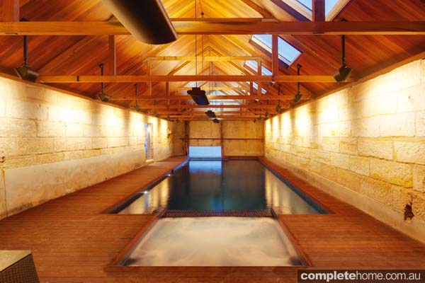 A unique indoor lap pool from Sunrise Pools built in a heritage boat house.