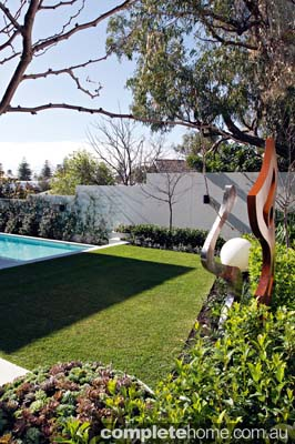 A garden sculpture in a contemporary landscape design from Tim Davies Landscaping.