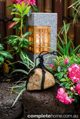 A decorative rock in an authentic Japanese garden from Kihara Landscapes.
