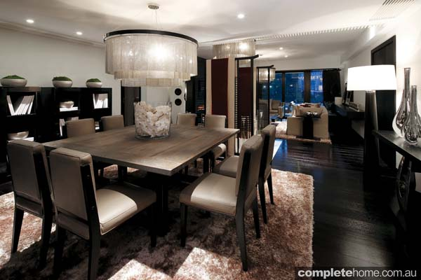 Living Room Design Square dining table with Chainmail Chandelier and furnishings