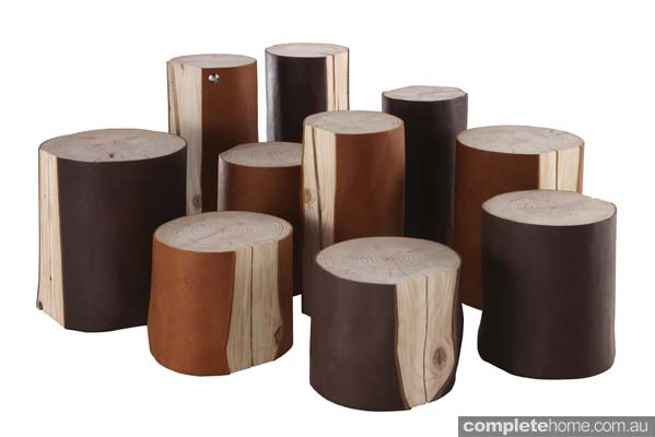 Recycled logs wrapped in leather tables and stools
