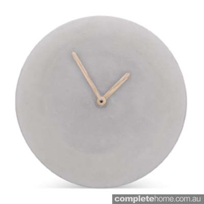 sleek concrete wall clock with oak veneer hands