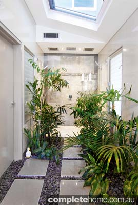 tropical style marble bathroom with skylights