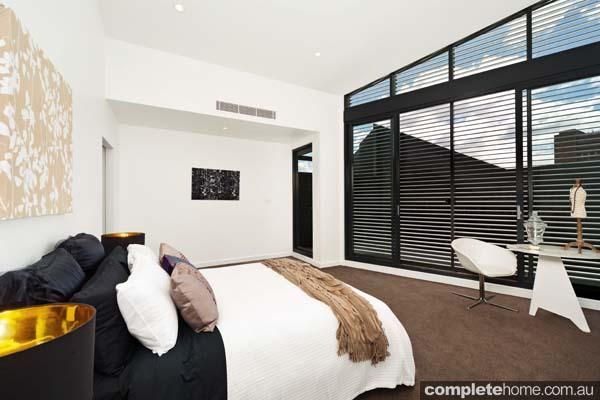 neutral modern design bedroom dark wood shutters