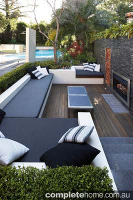 outdoor entertaining lounge area with fire place