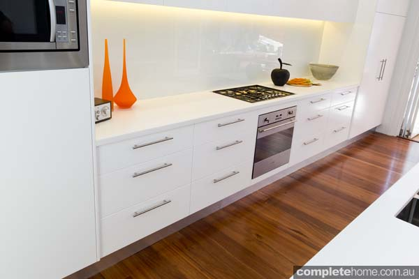 white and orange kitchen bench