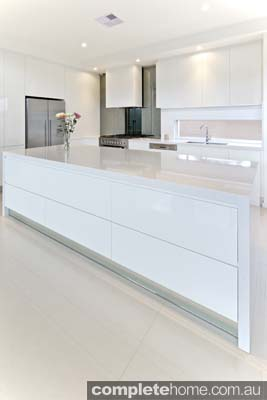 Carrera sleek white kitchen design - bench