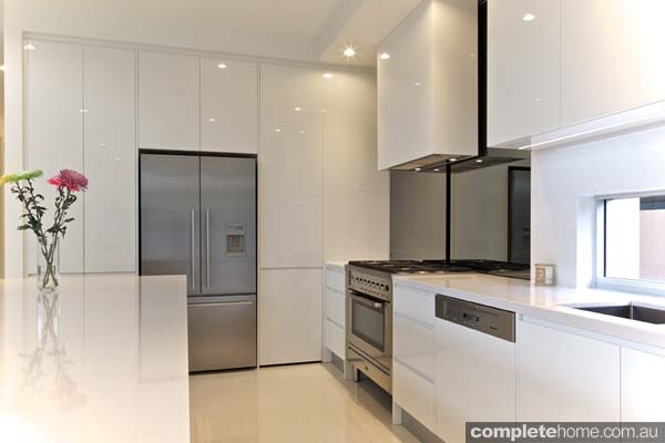 Carrera This project achieves a minimal look through its use of a sleek and simple kitchen design