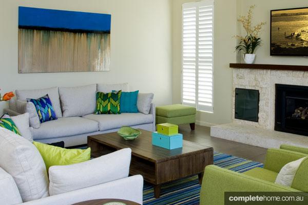 John Croft seaside home design - brightly coloured cushions