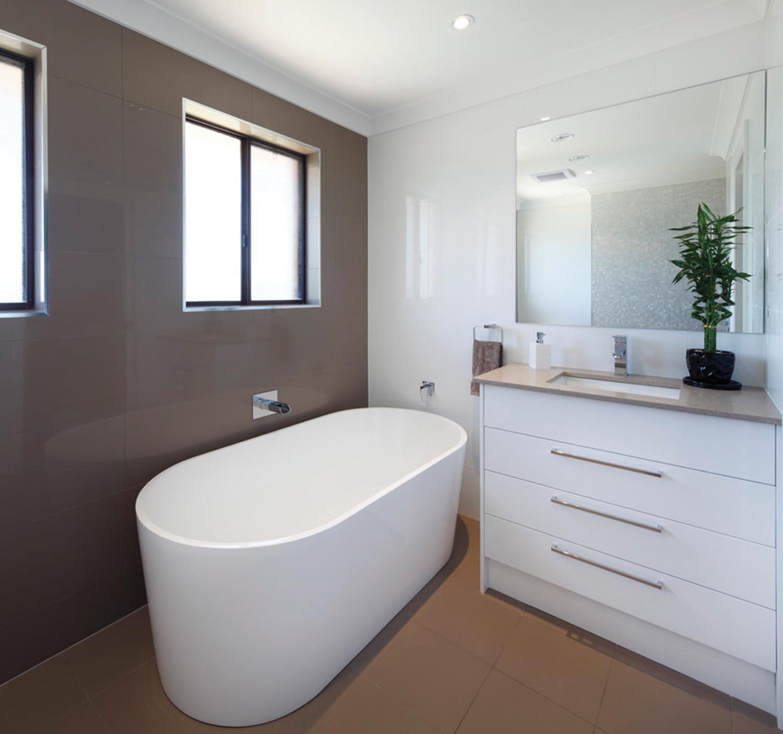 Gorgeous white bathroom with pearl tiles