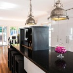 Pink, white and black kitchen design