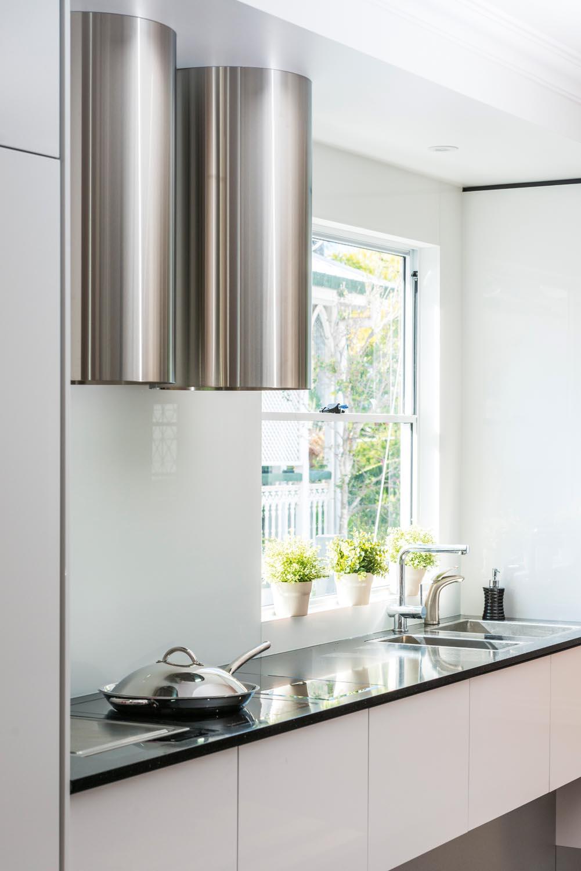 Pink, white and black kitchen design