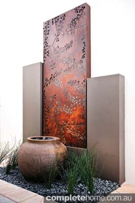 contemporary outdoor screen and fountain