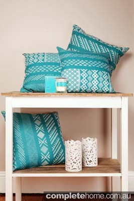 Blue cushion decor by Kathryn Ireland