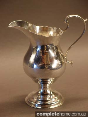 antique silver water jug or pitcher