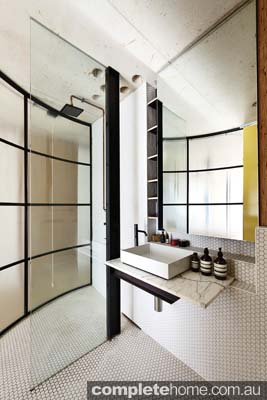 curved mosaic style bathroom