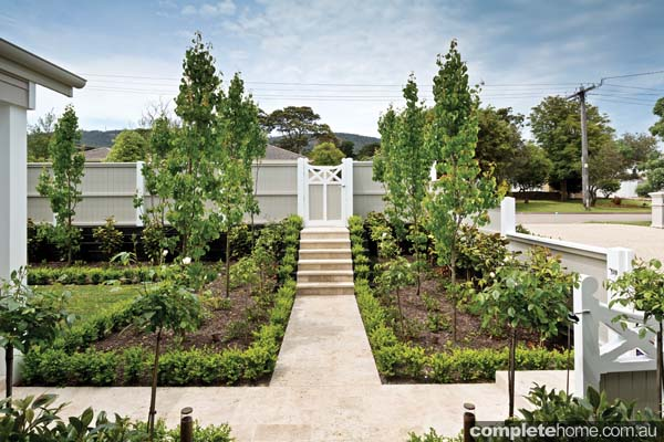 formal garden design with white gate