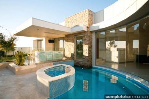 curvaceous pool and entertaining area