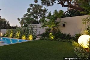 coastal living lush garden and lawn
