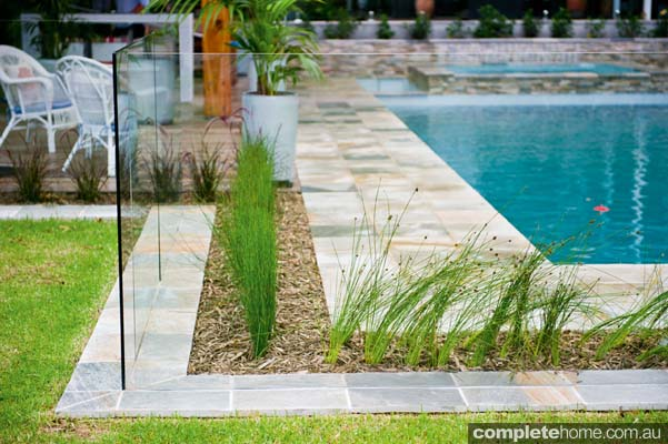 How to add a modern pool and garden to an existing home for Gardens around pools