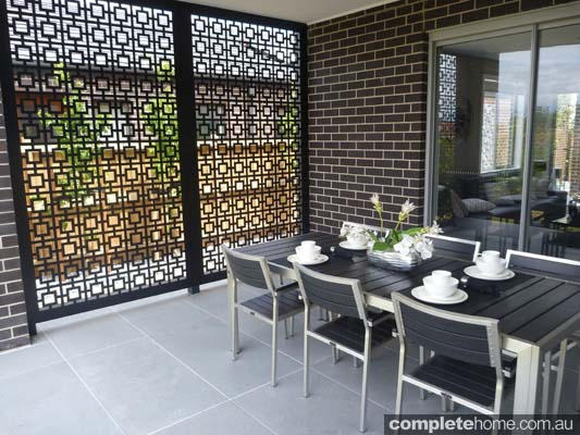 tombo designs metal privacy screen within an entertaining area