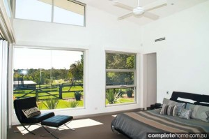 cathedral ceilings and country views from this modern bedroom
