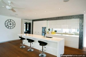 modern white kitchen with timber flooring