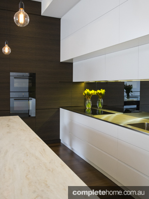 glossy white kitchen with invisible cupboards