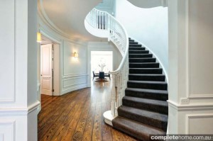 hamptons inspired modern sweeping staircase
