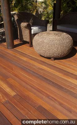 bali inspired thatch hut poolside with timber flooring