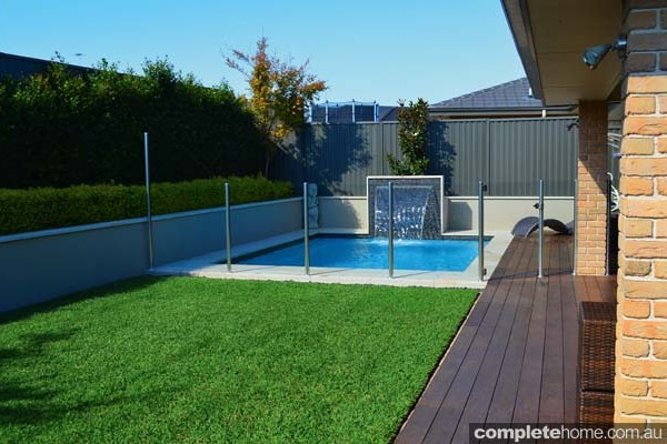 jakin pool with landscaping, fencing and water feature
