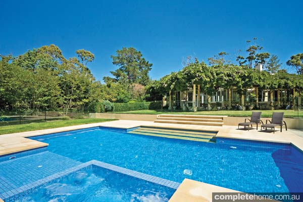 landscaped pool with tropical design features