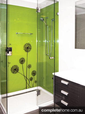 Gorgeous green splashback is enough to liven up any bathroom and add a natural feel
