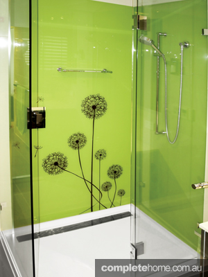 Gorgeous green splashback is enough to liven up any bathroom