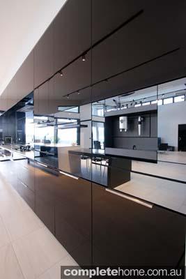 vanuatu enigma kitchen black gloss panelling and appliances
