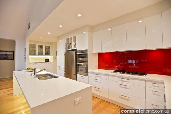 White Kitchen Red Splashback warm and homely kitchen design - completehome