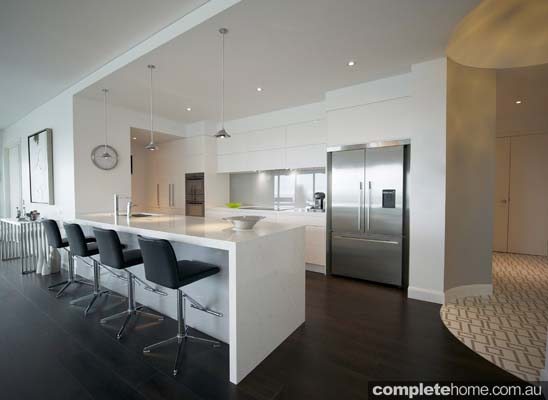 black and white kitchen with contemporary features and stainless steel accessories